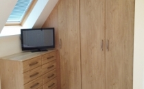 angled-wardrobe-in-natural-oak